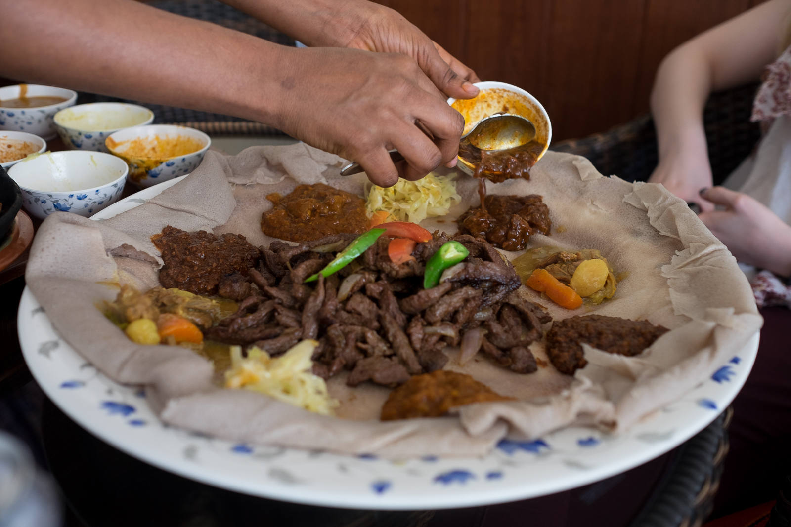 Ethiopian food served on an injera at the Bonne Anne restaurant, Abu Dhabi