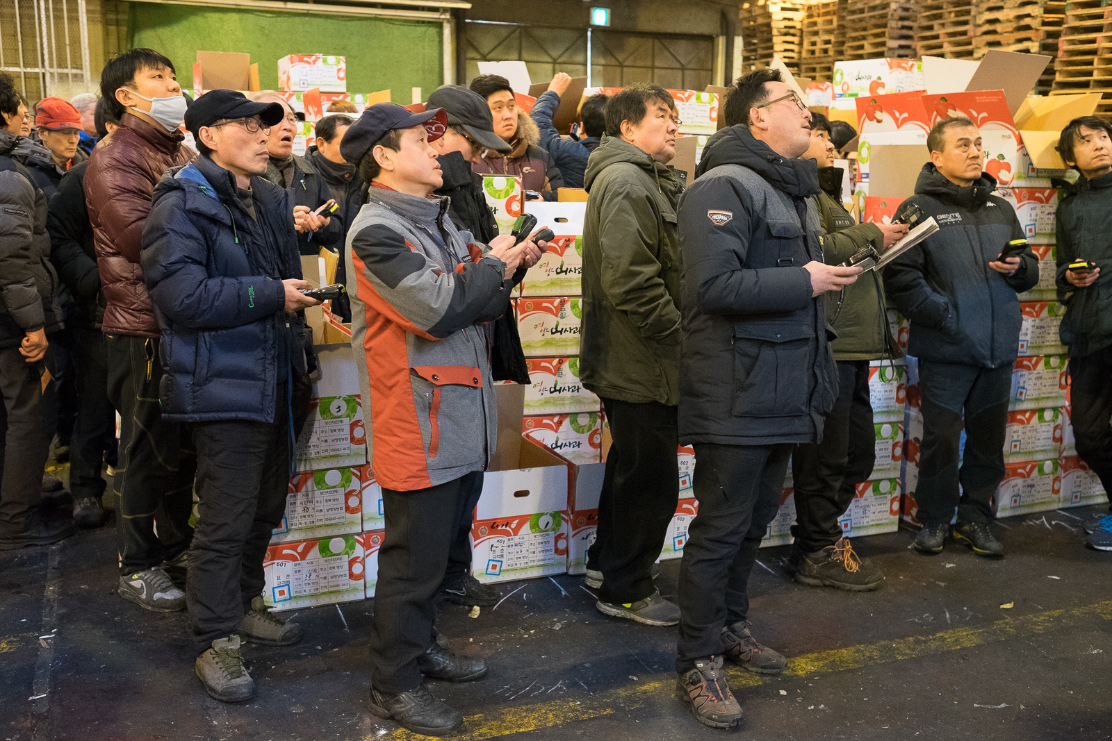 Bidders follow a fruit auction in Garak market